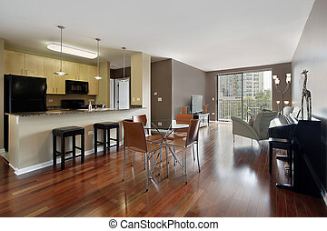 Condo with open floor pland and granite kitchen countertop