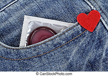 Condom in blue jeans pocket and red heart
