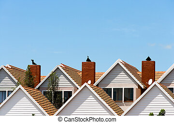 Condomimium houses. - Close up detail of town house rooftops...