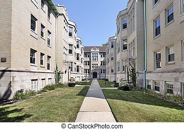 Condominium building in city with long walkway