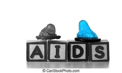 Condoms falling on blocks spelling AIDS in slow motion