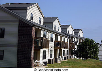 A row of condominiums showing the great mix of brick and vinyl siding for exterior cladding.