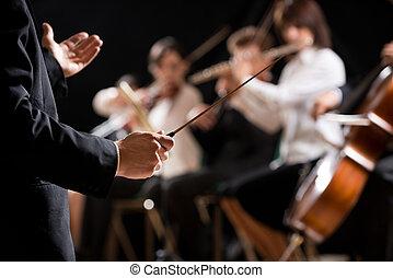 conductor orquesta, sobre el escenario