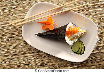 cone sushi and chop stick - a cone sushi on white plate and ...