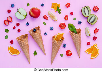 Cones and colorful various fruits raspberry ,blueberry...