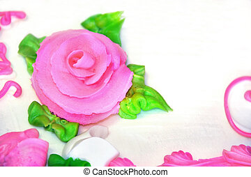 Confection in a Rose - Pink confection rose sits on white...