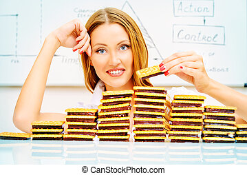 confectionary - Beautiful businesswoman posing with cookies...