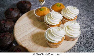 Confectioner decorated with vanilla cream freshly cooked...