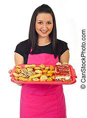 Confectioner female offering cakes - Smiling confectioner...