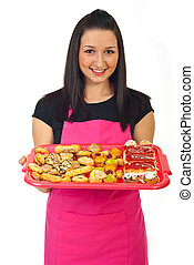 Confectioner female offering cakes - Smiling confectioner...