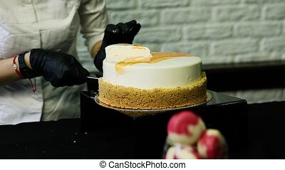 confectioner hands cut by knife white mousse cake -...