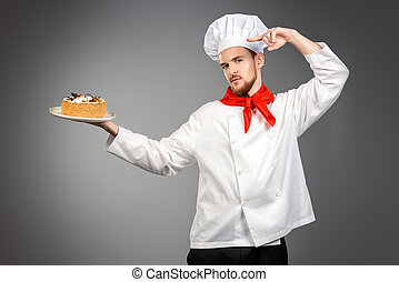 confectionery - Portrait of a male confectioner cooking a...