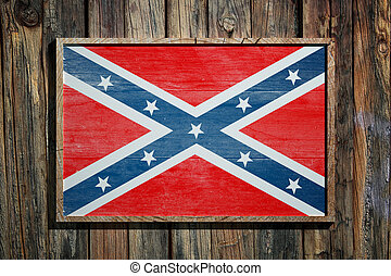 Confederate flag on wooden background