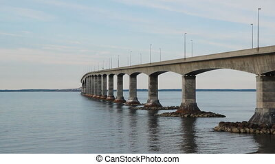Confederation bridge linking New Brunswick and Prince Edward Island. Camper van starts crossing halfway through clip. Canada.