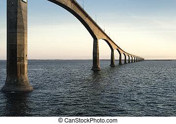 Confederation Bridge over sunset sky, Northumberland Strait, Prince Edward Island, Canada