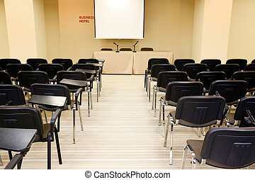 Conference hall - Image of several rows of armchairs in...