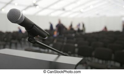 Conference of lecture - microphone on stage in auditorium...