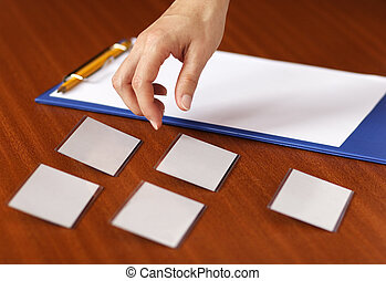 Conference register - Hand picking a name tag at a ...