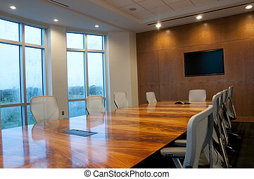 Conference Room with table, chairs, and windows.