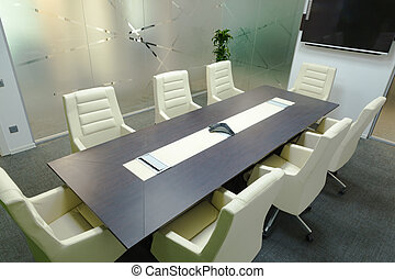 Conference room with screen.
