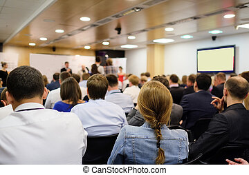 conference - The audience listens to the acting in a...