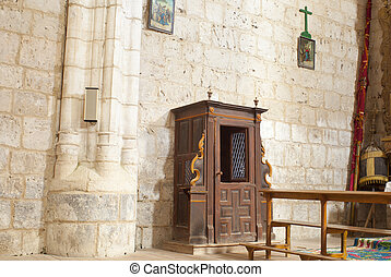 Confessional in a old church in Spain
