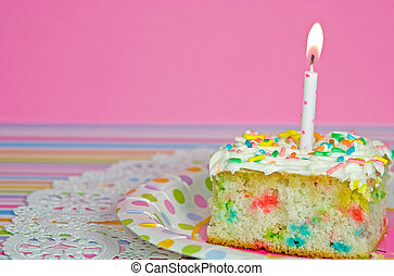 Confetti cake with candle - Candle in a slice of confetti...