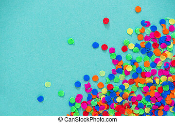 Confetti carnival decoration red green yellow blue paper background