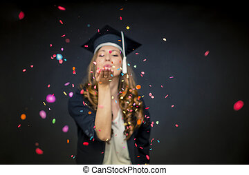Confetti girl with graduation hat and black background