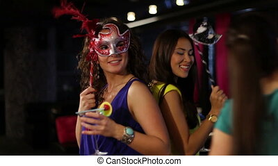 Confetti - Girls in masks partying when their friend fires a...