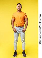 confiant, appareil photo, corps, blanc, mains, type, orange, prise, hipster, sourire, pose, désinvolte, vertical, jeune, debout, t-shirt, coup, pantalon, content, mascular, plein-longueur, poches, studio