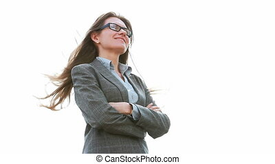Confidence - Smiling businesswoman standing in a confident...