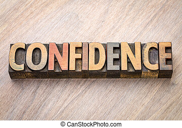 confidence word abstract in wood type