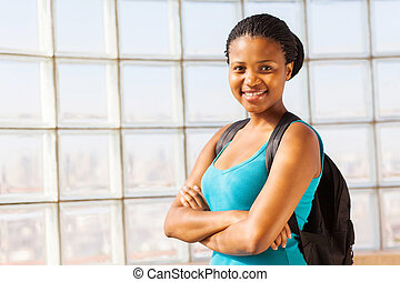 confident african college student with arms folded