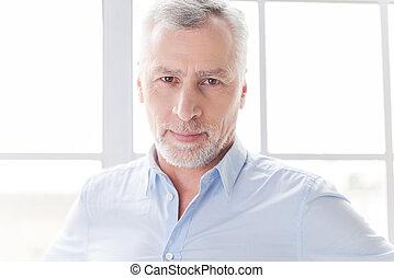 Confident and successful. Confident grey hair senior man in...