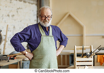 Confident and successful old grey haired man with hands on...