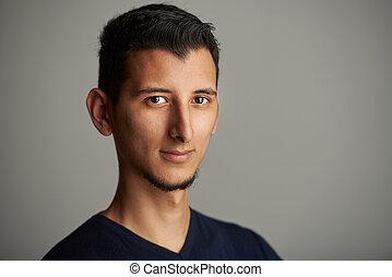Confident arab young man