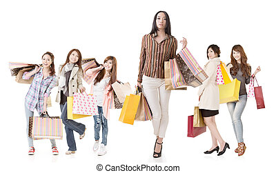 Confident Asian shopping woman with her friends