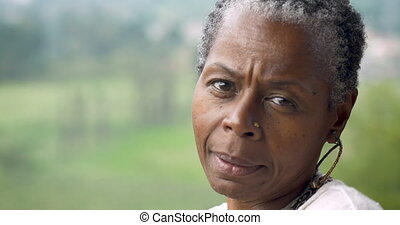 Confident attractive African American woman flirting and...