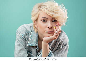 confident awesome blond girl with pensive look