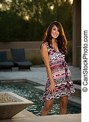 Confident beautiful brunette fashion model