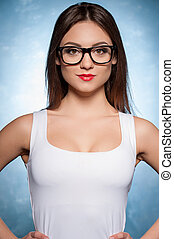 Confident beauty. Beautiful young woman looking at camera