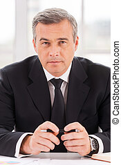 Confident business expert. Confident mature man in ...