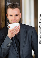 Confident Business Man Drinking Coffee