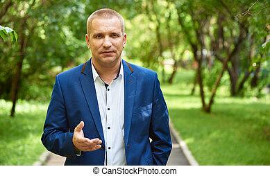 confident business man in the park - Portrait of a confident...
