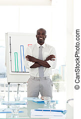 Business man smiling arms folded