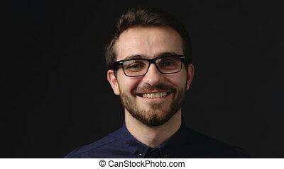 Confident business man smiling at camera - Closeup portrait...