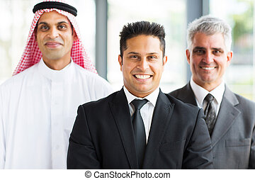 business partners looking at camera - confident business ...