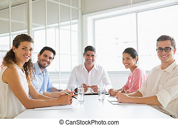 Confident business people at conference table