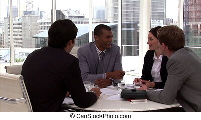 Confident business people having a brainstorming in a company